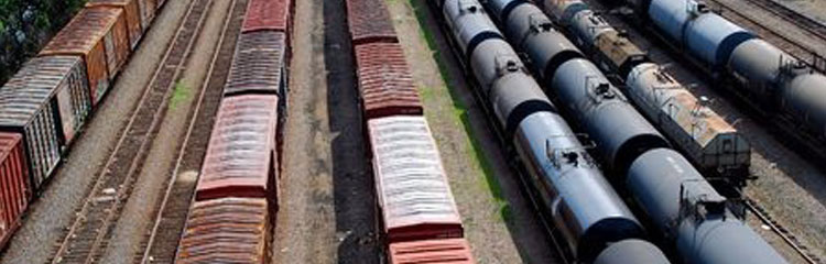 Remove oil from water in railroad yards