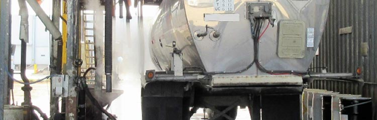 Remove oil from water at tank truck wash facilities
